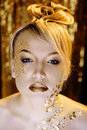 Beauty blond woman with gold creative make up close Royalty Free Stock Photography