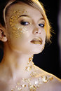 Beauty blond woman with gold creative make up close Royalty Free Stock Images