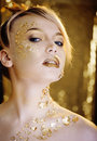 Beauty blond woman with gold creative make up close Stock Photos
