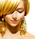 Beauty blonde model fashion girl with golden earrings Royalty Free Stock Photos
