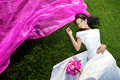 Beauty bride with a long purple veil Royalty Free Stock Photos
