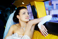 Beauty bride in wedding limousine Royalty Free Stock Photography