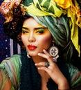 Beauty bright woman with creative make up, many shawls on head like cubian, ethno Royalty Free Stock Photo