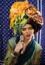 Beauty bright woman with creative make up, many shawls on head like cubian, ethno look closeup Royalty Free Stock Photo
