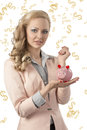 Beauty business woman with piggybank pretty pink jacket and curly elegant hair style taking in the hand and smiling Royalty Free Stock Photo