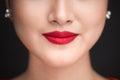 Beauty. Close up view of beautiful woman lips with red matt lips Royalty Free Stock Photo
