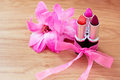 Beauty cosmetics: lipsticks, bow and flowers Stock Photography