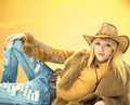 Beauty cowgirl on brown