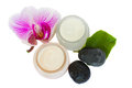 Beauty creams  with orchid and spa stones Royalty Free Stock Photo
