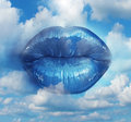 Beauty dreaming glamour concept with angelic female glossy lips in the sky as a metaphor for romance and visions of falling in Royalty Free Stock Images