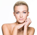 Beauty face of beautiful young woman isolated blond with clean skin on white Royalty Free Stock Photo