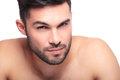 Beauty face of an un shaved naked young man looking at the camera Royalty Free Stock Image