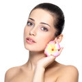 Beauty face of young woman with flower beauty treatment concept portrait over white background Royalty Free Stock Image