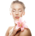 Beauty face of the young woman with pink lily this image has attached release Stock Images