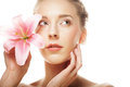 Beauty face of the young woman with pink lily this image has attached release Stock Photos