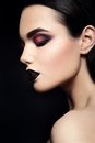 Beauty Fashion Model Girl with Black Make up. Dark Royalty Free Stock Photo