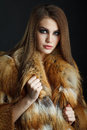 Beauty fashion model girl in fox fur coat haircut hairstyle professional makeup style woman Stock Image