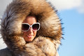 Beauty fashion model girl in fur coat winter woman a photo of beautiful is clothes Stock Photography