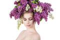 Beauty fashion model Girl with Lilac Flowers Hairstyle. Royalty Free Stock Photo
