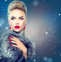Beauty fashion model girl in ox fur coat blue fox Stock Images