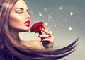 Beauty fashion model woman with red rose flower face portrait Stock Photography