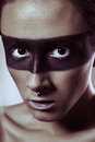 Beauty fashion shot of young man with nose rings and black strip line makeup and white eyelash. Male beauty portrait Royalty Free Stock Photo