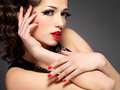 Beauty fashion woman with red nails and makeup lips golden eye on black background Stock Image