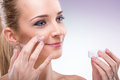 Beauty flawless skinned woman with face cream Stock Photography
