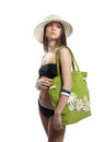 Beauty girl in black bikini with green beach bag Royalty Free Stock Image