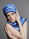 Beauty girl in blue cap and scarf Royalty Free Stock Photo