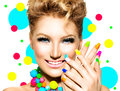 Beauty girl with colorful makeup nail polish and accessories Stock Photos