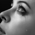 Beauty girl cry on black background Royalty Free Stock Images