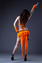 Beauty girl dance in orange go-go costume Royalty Free Stock Images