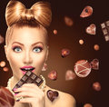 Beauty girl eating chocolate