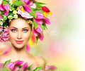 Beauty girl with flowers hairstyle summer model colorful Stock Photography