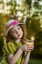 Beauty girl with juce outdoors Stock Photo