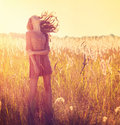 Beauty girl outdoor teenage model posing in sun light Royalty Free Stock Photos