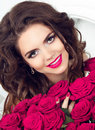 Beauty girl portrait. Happy smiling teen with pink roses bouquet Royalty Free Stock Photo