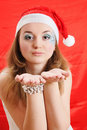 Beauty girl in Santa hat Stock Photos