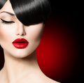 Beauty girl with trendy fringe hairstyle fashion glamour Royalty Free Stock Photo