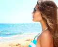 Beauty girl wearing sunglasses over ocean vacation concept Royalty Free Stock Photo