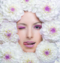 Beauty girl with white flowers around her face dahlia beautiful makeup concept Stock Image