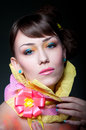 Beauty glamour portrait pretty woman model colorful makeup glossy lips small rose earrings extraordinary wrapping paper collar Stock Photos