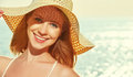 Beauty happy woman in hat enjoy sea at sunset on beach Royalty Free Stock Photo