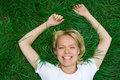 Beauty happy woman lie grass Royalty Free Stock Photo