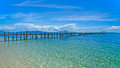 Beauty of kanawa island wooden pier stretching out to sea Royalty Free Stock Image