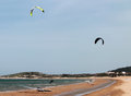 Beauty kite surfer on a beach Stock Photos