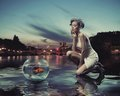 Beauty lady with gold fish Royalty Free Stock Photo