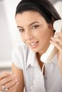 Beauty on landline call with dark hair gesturing smiling Stock Photos