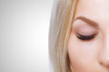 Beauty makeup for blue eyes. Part of beautiful face closeup. Perfect skin, long eyelashes, make up concept. Royalty Free Stock Photo